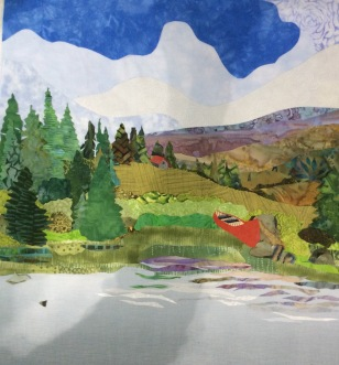 A red canoe was added and to balance it, a little red roofed cabin on the hill. I was not happy with the rock. I had also changed the grasses at the edge of the lake
